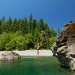 people jumping into Chetco River