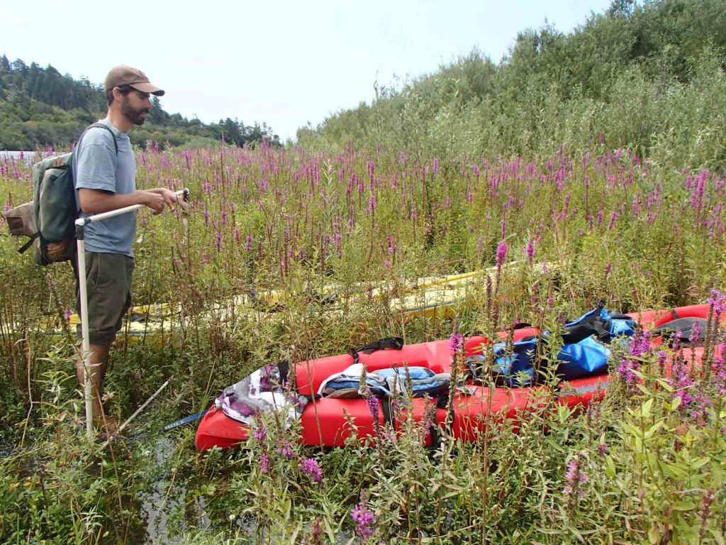 equipment and kayak at river
