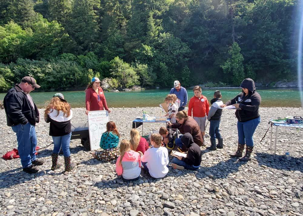 teaching children on river bank