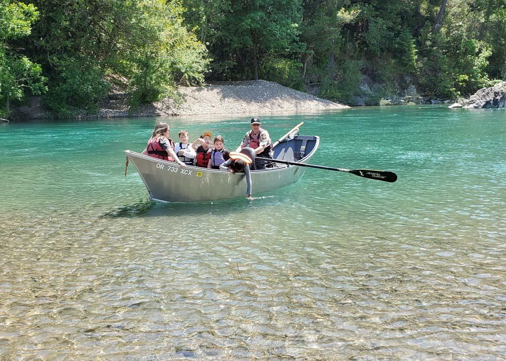 children in a drift boat