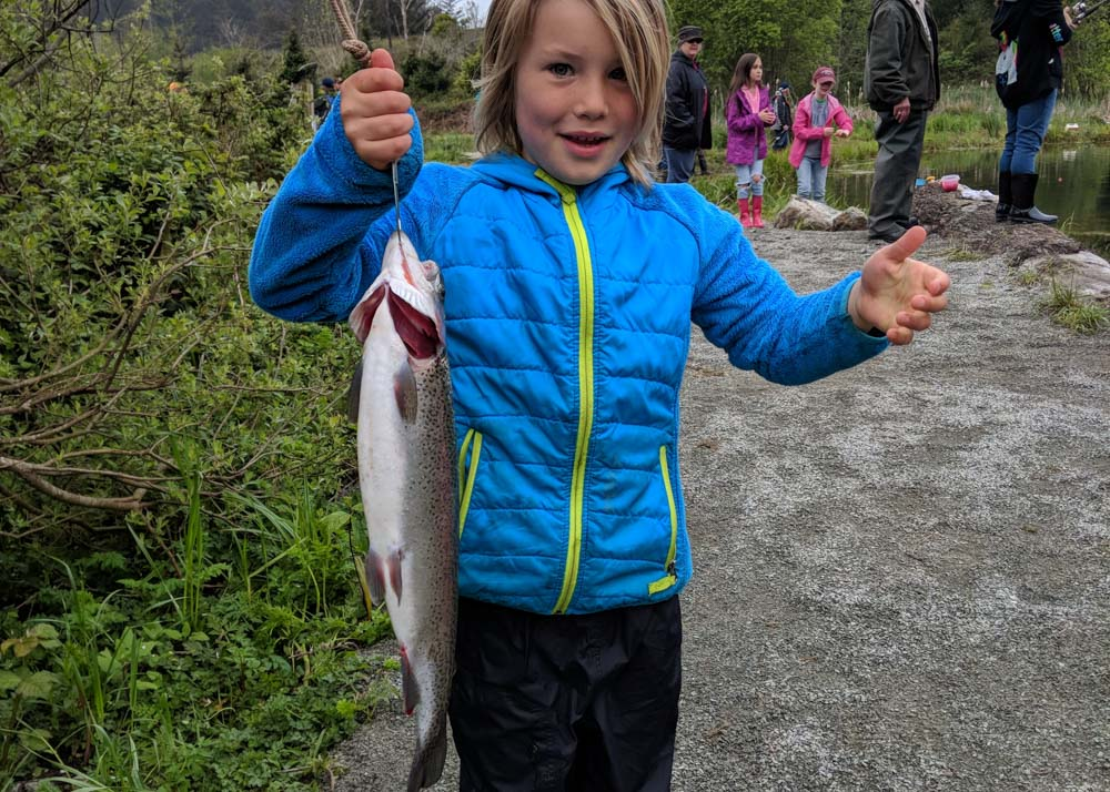 child holding a large fish